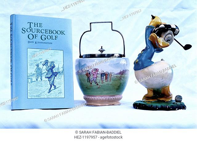 The Sourcebook of Golf, ornamental ware, Donald Duck figure, 1930-81. (Left): The Sourcebook of Golf by Don Kennington, 1981: (Centre): Ornamental porcelainware