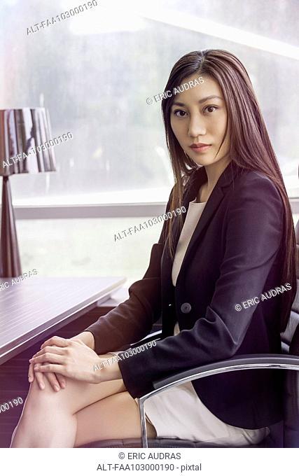 Business woman at desk, portrait