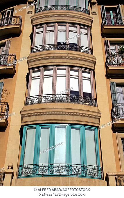 glass windows in modernist building of Gran Via de Les Corts Catalanes, Barcelona, Catalonia, Spain