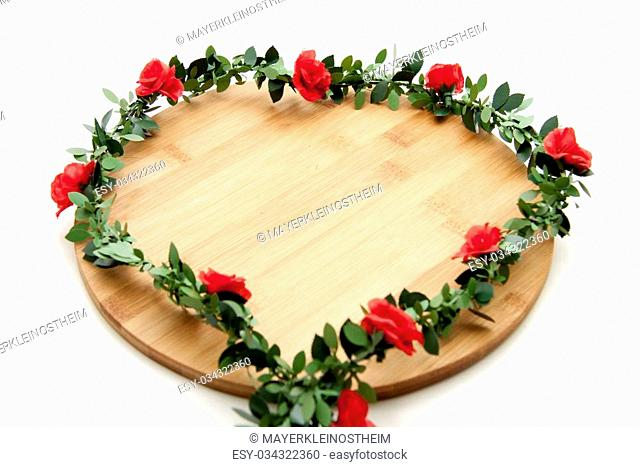 Rose garland with edge board on white background