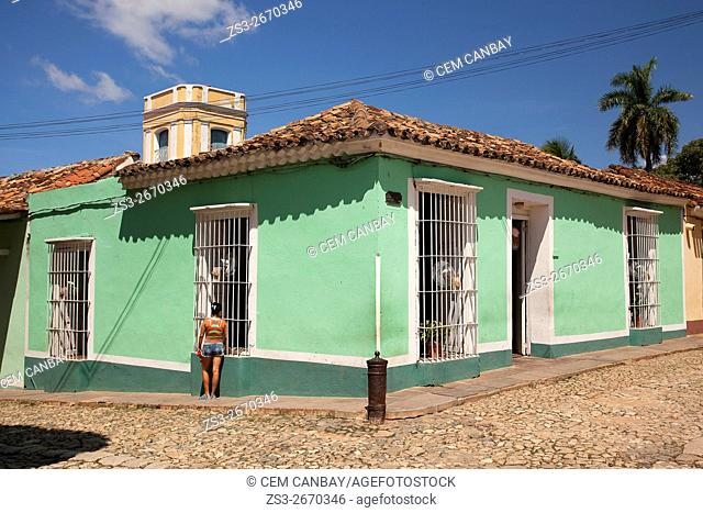 Woman having a chat at the street in the town center, Trinidad, Sancti Spiritu Province, Cuba, West Indies, Central America