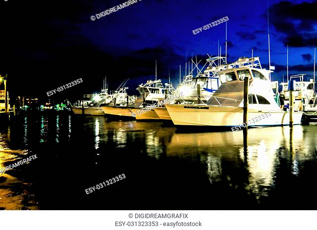 Marina with docked fishing boats at the end of the day