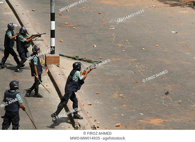 Riot police firing tear gas cells on Islamic activists during a clash on the issue of 'Women policy', in front of Baitul Mukarram mosque, in Dhaka