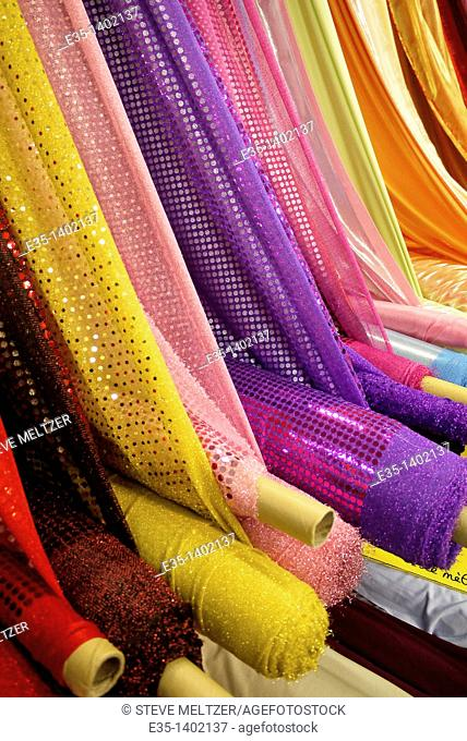 Bolts of colored fabric at a fabric shop in Pezenas, France