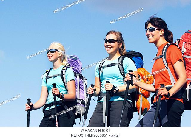 Mother with two teenage daughters hiking