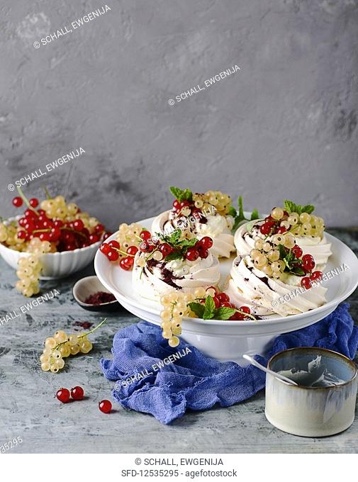 Mini pavlovas with cream and redcurrants