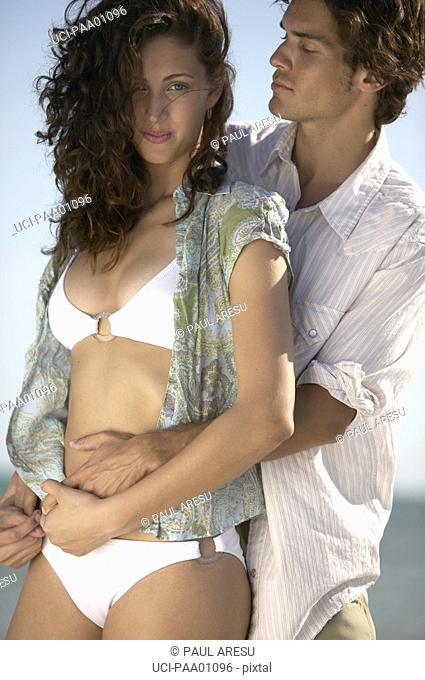 Young Hispanic couple hugging