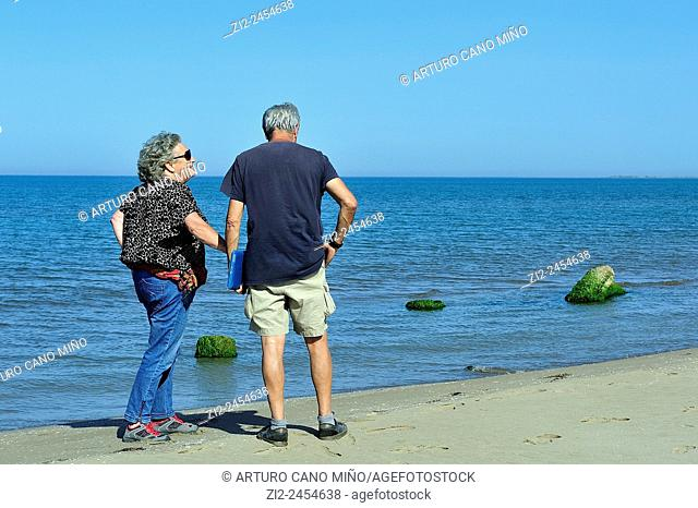 A couple on the beach. Ebro Delta Natural Park. Tarragona, Spain