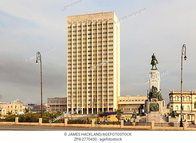 """Hermanos Ameijeiras Hospital (Hospital Clínico Quirúrgico """"""""Hermanos Ameijeiras"""""""") with the Antonio Maceo Statue in Central Havana, Cuba"""