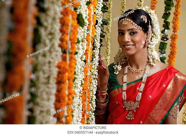 Selective focus of bride standing by garlands