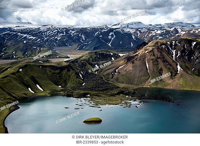 Aerial view, Lake Frostastaðavatn with snow-covered rhyolite mountains, Námshraun lava field, Landmannalaugar, Fjallabak Conservation Area, Icelandic Highlands