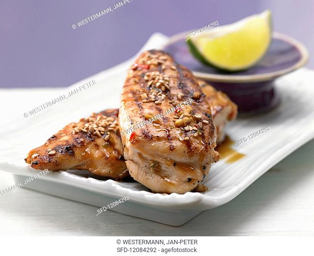 Chicken breast covered in sesame seeds with chilli & honey sauce (Asia)