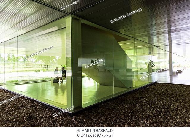 Business people talking in modern office lobby