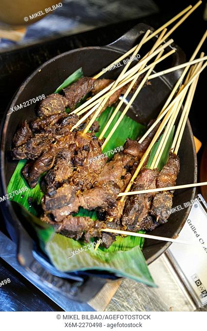 Traditional cooking (beef satay). Marina Center. Singapore, Asia