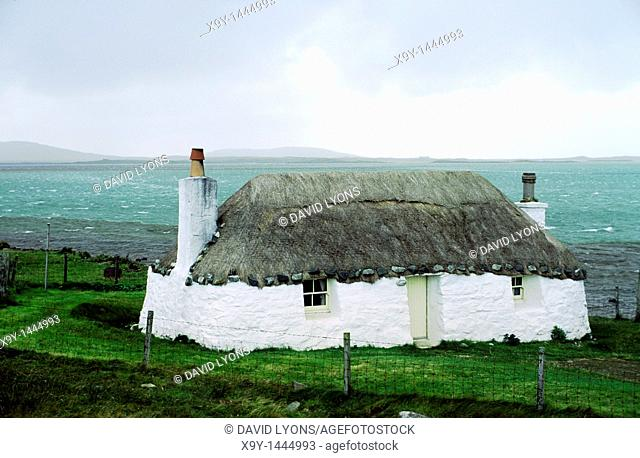Outer Hebrides island of North Uist, Scotland, UK  Traditional croft house thatched cottage at Malacleit