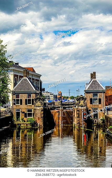 Historical sluice at Zaandam with buildings and water, Zaandam, the Netherlands