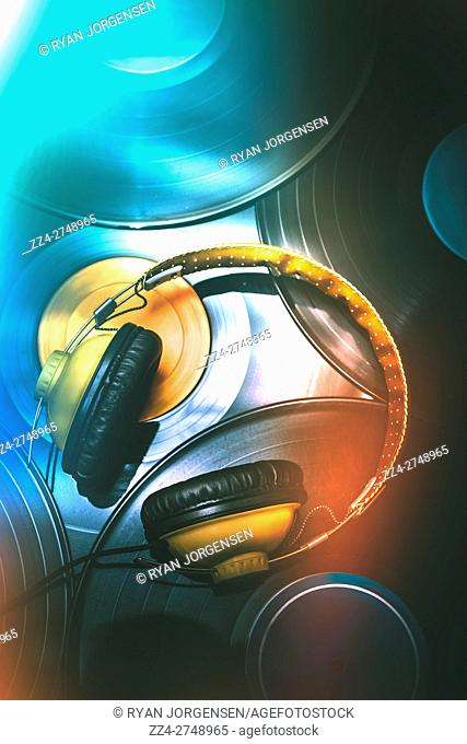 Retro night clubbing mixup on toned headphones with vinyl records over disco light leaks. Sound trance