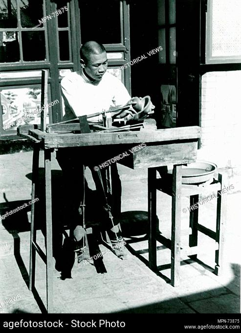 Photograph of Jade Carvers at Work: The Curved Wheel, Wanzi. Date: 20th century; Culture: China; Medium: Photograph; Dimensions: Image: 2 7/16 x 3 1/16 in