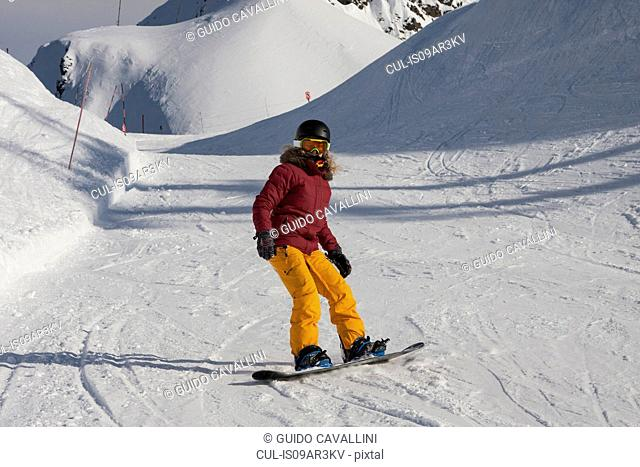 Young woman snowboarding, Girdwood, Anchorage, Alaska