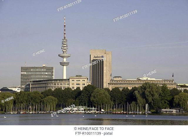View across a river to the television tower, Alster, Hamburg, Germany