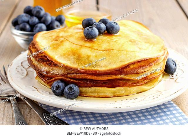 Stack of pancakes with syrup and blueberries. Party dessert