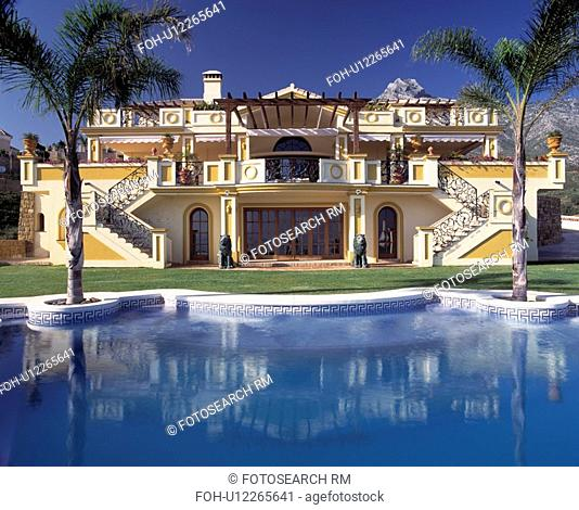 Swimming pool in front of large modern villa in Southern Spain