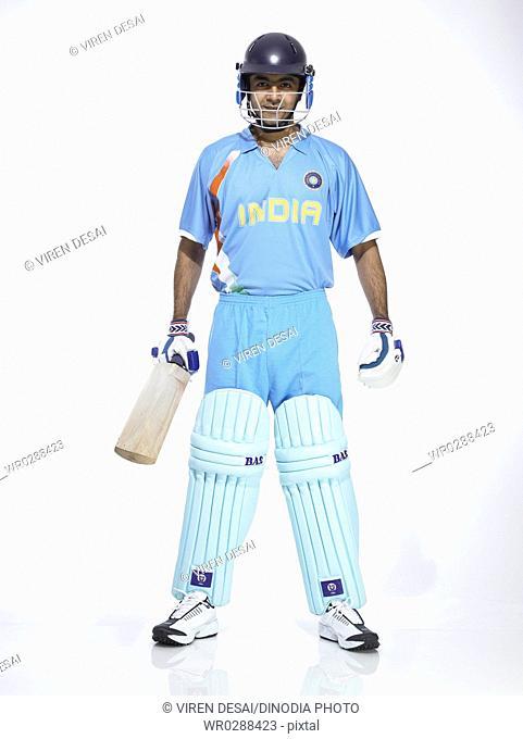 Indian batsman holding bat wore helmet ready for cricket match MR702A
