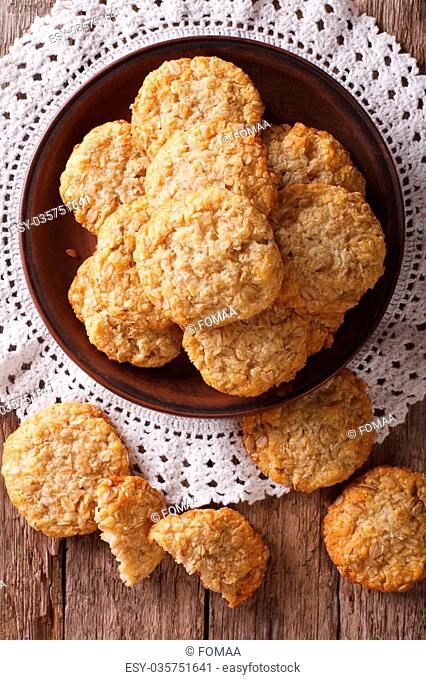 Freshly baked Australian ANZAC biscuits close up on the table. vertical view from above