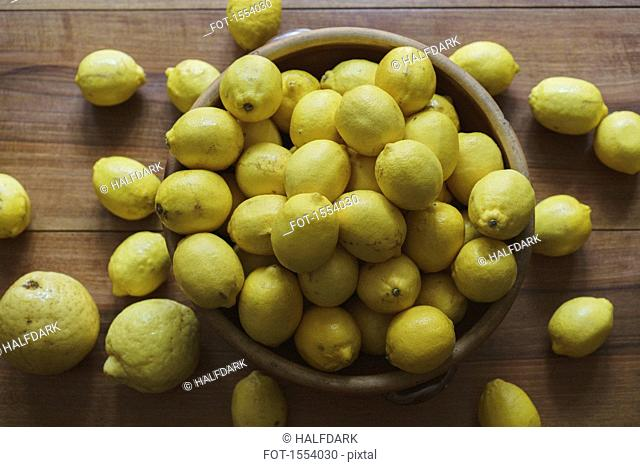 Directly above shot of lemons in container on table