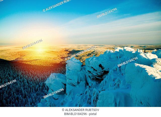 Snowy hilltop overlooking remote landscape
