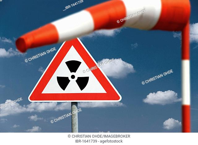 Wind vane, radioactivity warning sign, radioactive cloud, montage