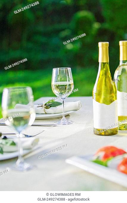 Wine glasses with a wine bottle on a table