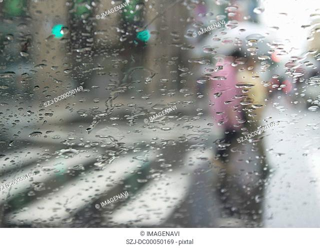 Rainy street view through a window