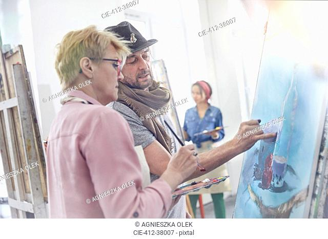 Artists painting in art class studio