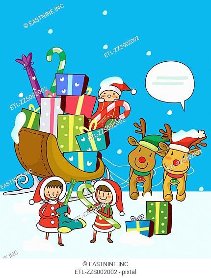 Girls standing near a sleigh of Christmas presents