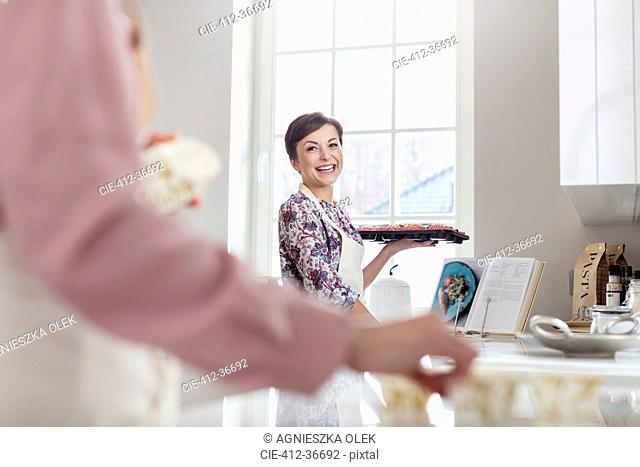 Smiling woman baking in kitchen