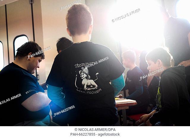 Luca-Joel (C) wears a t-shirt that reads 'Stemmer Loeschloewen' (Stemmer lion extinguishers) in Bad Steben, Germany, 06 February 2016