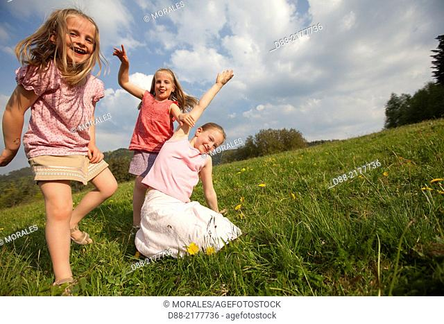 France, Bas Rhin,Urbeis near the Climont,girls in a meadow