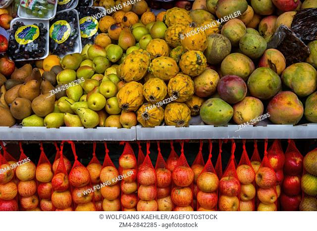 Colorful fruits for sale on the local food market in the town of Otavalo in the highlands of Ecuador near Quito