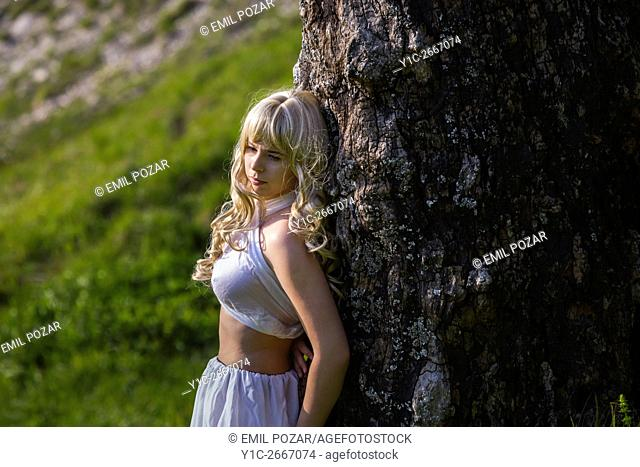 Teen girl in White clothing in nature