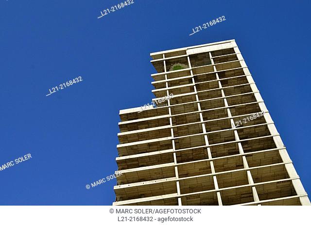 Block of flats under construction, blue sky. Barcelona, Catalonia, Spain