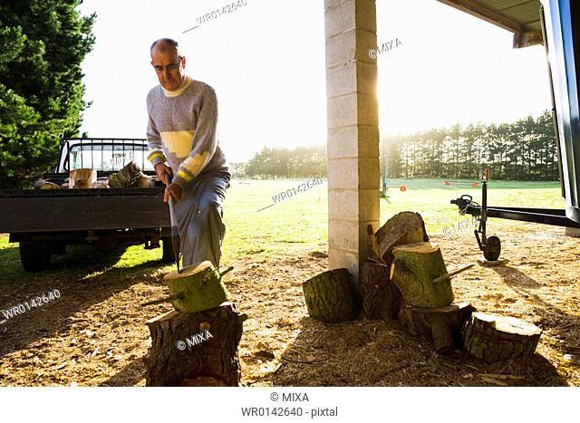 Senior man chopping wood