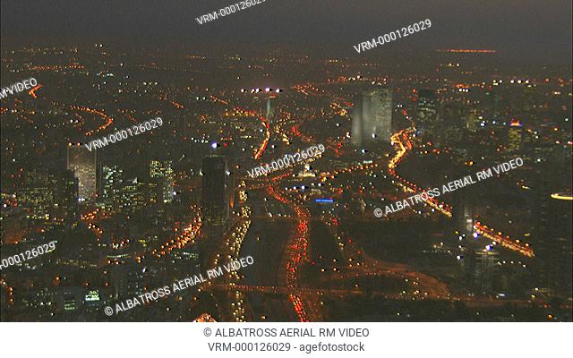 Aerial Tel Aviv city at night (Azrielli Towers) and highway