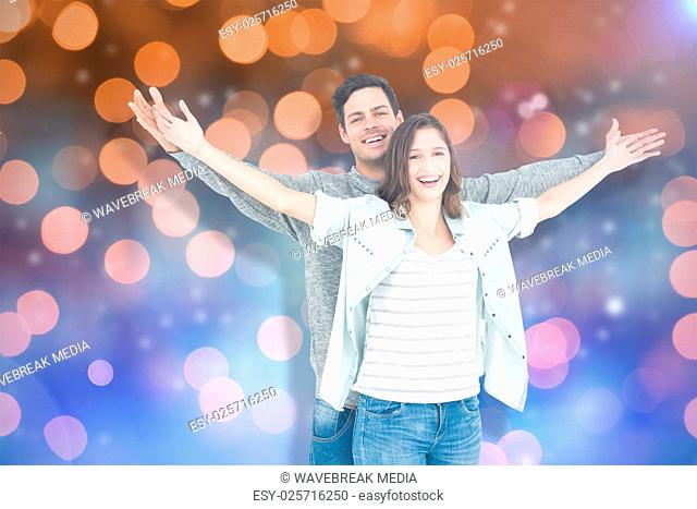 Composite image of couple embracing with arms outstretched