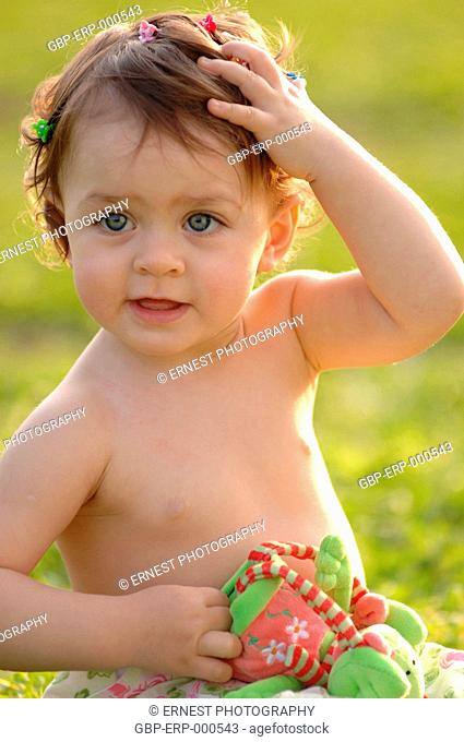 Baby, girl; 1 year, isolated, green background