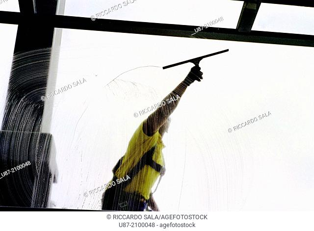 Germany, Berlin, Reichstag Dome, Man Cleaning Windows of the Dome