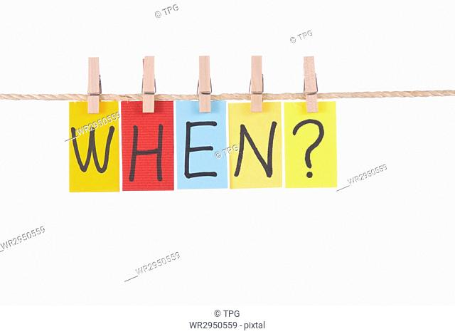 When, Colorful words hang on rope by wooden peg