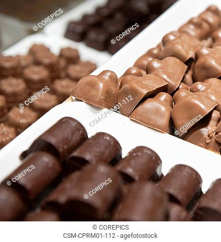 Assorted chocolate pralines on display at a delicatessen shop in The Hague, Netherlands