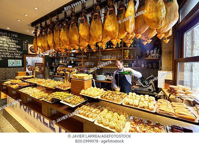 Waiter serving txakoli wine, Ham, Pintxos, Bar Restaurante Portaletas, Parte Vieja, Old Town, Donostia, San Sebastian, Gipuzkoa, Basque Country, Spain