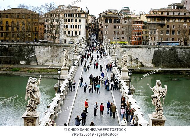 Tourists cross Angels' Bridge over Tiber River in Rome, March 9, 2008 The bridge was constructed in 136 AD to connect the city of Rome to Hadrian's Mausoleum